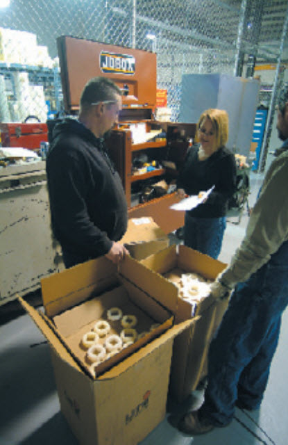 NortNorthwind employees inspect and prepare packaging for shipment to customer